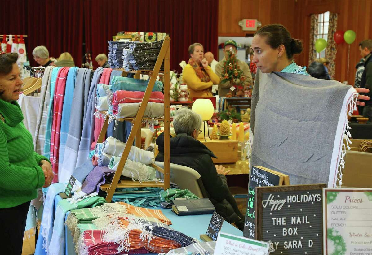 Suzan Zanbak of Milford-based Blue Lily Cotton shows her wares at the Holiday Craft Fair at Jesse Lee United Methodist Church on Saturday, Nov. 9, 2019, in Easton, Conn.