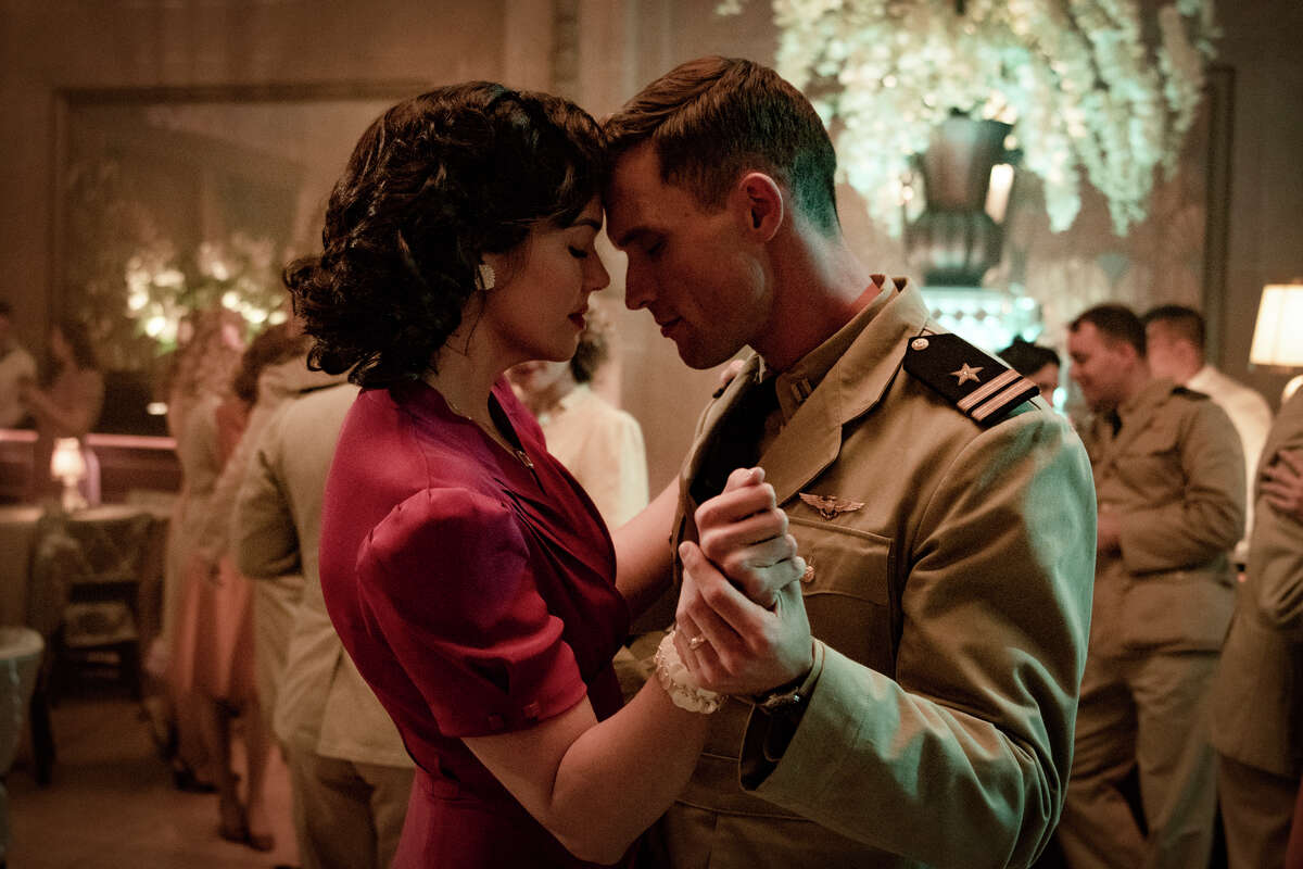 This image released by Lionsgate shows Mandy Moore, left, and Ed Skrein in a scene from