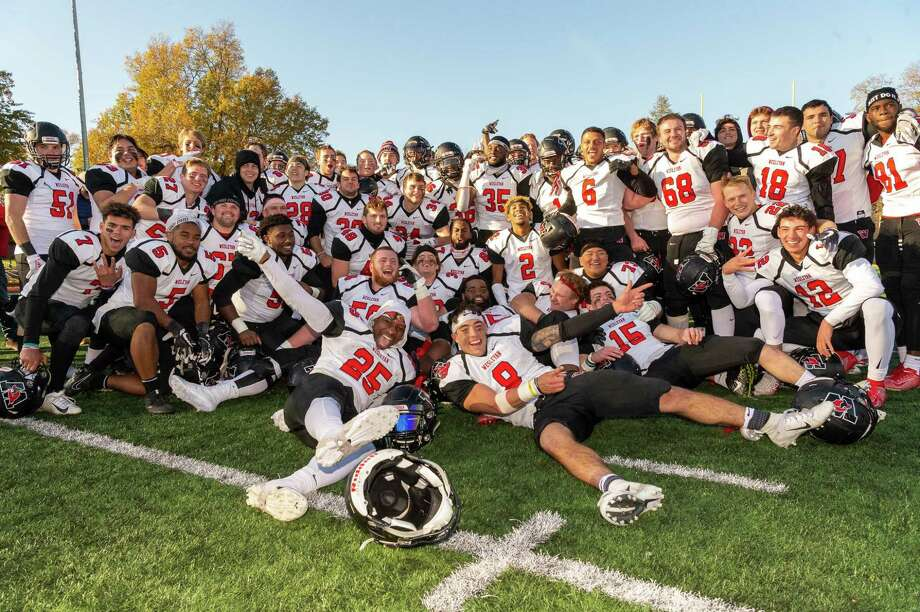 Wesleyan celebrates its win over Trinity. Photo: Steve McLaughlin Photography / Contributed Photo Via Wesleyan Athletics