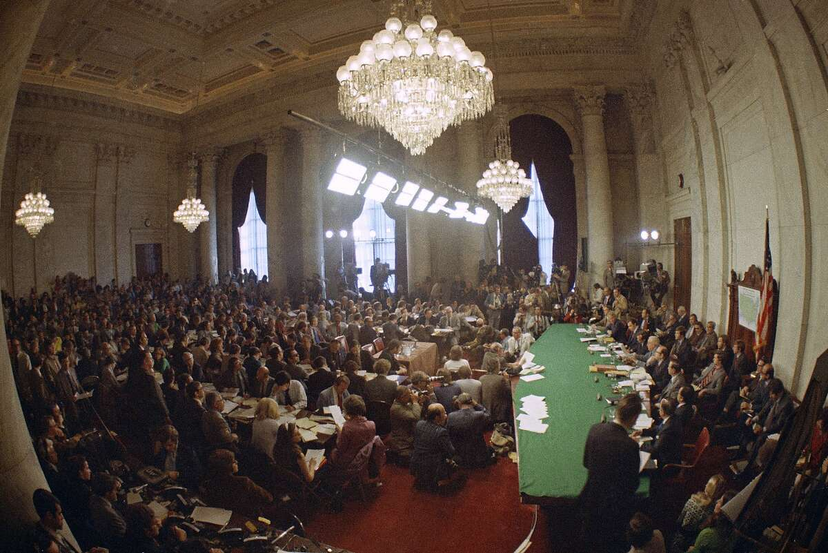 """FILE - In this May 18, 1973, file photo, the hearing of the Senate select committee on the Watergate case on Capitol Hill in Washington. In 1973, millions of Americans tuned in to what Variety called """"the hottest daytime soap opera"""" _ the Senate Watergate hearings that eventually led to President Richard Nixon's resignation. For multiple reasons, notably a transformed media landscape, there's unlikely to be a similar communal experience when the House impeachment inquiry targeting Donald Trump goes on national television starting Nov. 13, 2019. (AP Photo)"""