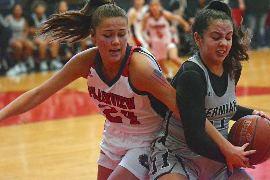 Plainview's Aspin Miller fights for a rebound with Odessa Permian's Camila Leal during their girls basketball game on Saturday afternoon in the Dog House. Photo: Nathan Giese/Planview Herald