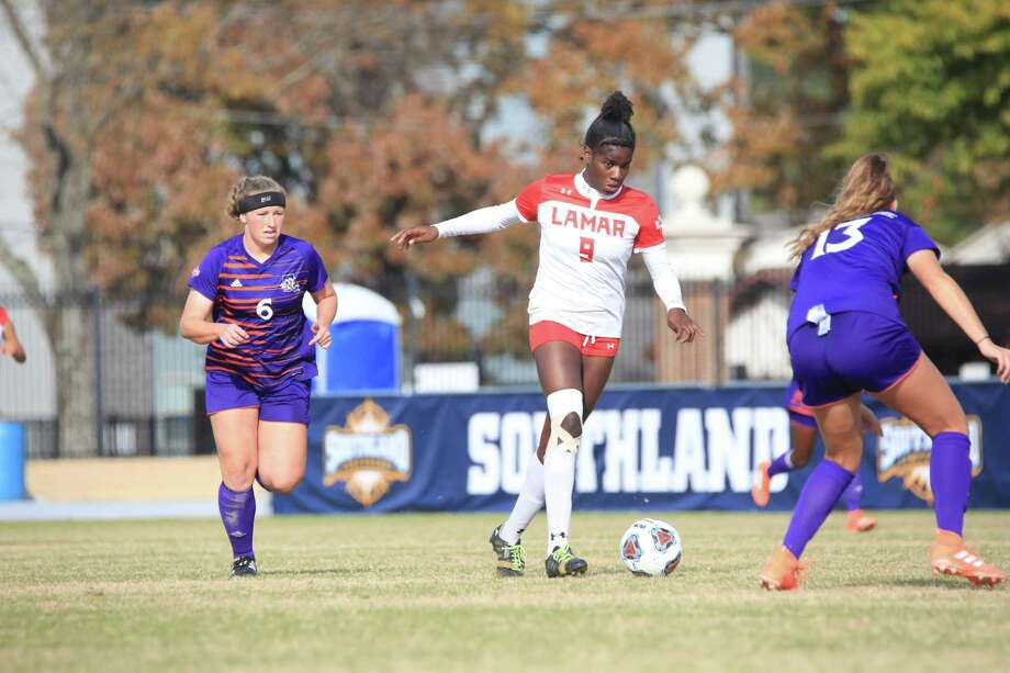 Lamar forward Esther Okoronkwo works her way through two Demon defenders during the Southland Conference Championship game on Sunday in Conway, Arkansas. Lamar won the game over Northwestern State, 3-1. Photo: Provided By Lamar Athletics.