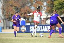 Lamar forward Esther Okoronkwo works her way through two Demon defenders during the Southland Conference Championship game on Sunday in Conway, Arkansas. Lamar won the game over Northwestern State, 3-1.