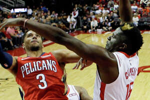 New Orleans Pelicans guard Josh Hart (3) shoots as Houston Rockets center Clint Capela, right, defends during the second half of an NBA basketball game, Saturday, Oct. 26, 2019, in Houston. (AP Photo/Eric Christian Smith)