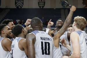 Rice players celebrate their victory with a video camera on court after defeating Pennsylvania in an NCAA basketball game Saturday, Nov. 9, 2019 in Houston, TX.