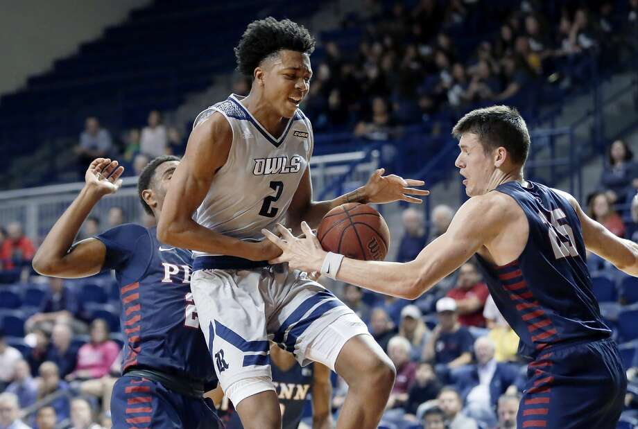 Rice's Trey Murphy III (2) has his drive to the basket broken up by Pennsylvania forward AJ Brodeur (25) and Pennsylvania guard Bryce Washington, left, during the first half of an NCAA basketball game Saturday, Nov. 9, 2019 in Houston, TX. Murphy recorded his first career double-double with a game-high 21 points and 10 rebounds in the Owls' win over St. Thomas on Thursday. Photo: Michael Wyke/Contributor