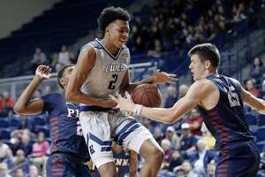 Rice guard Trey Murphy III (2) has his drive to the basket broken up by Pennsylvania forward AJ Brodeur (25) and Pennsylvania guard Bryce Washington, left, during the first half of an NCAA basketball game Saturday, Nov. 9, 2019 in Houston, TX.