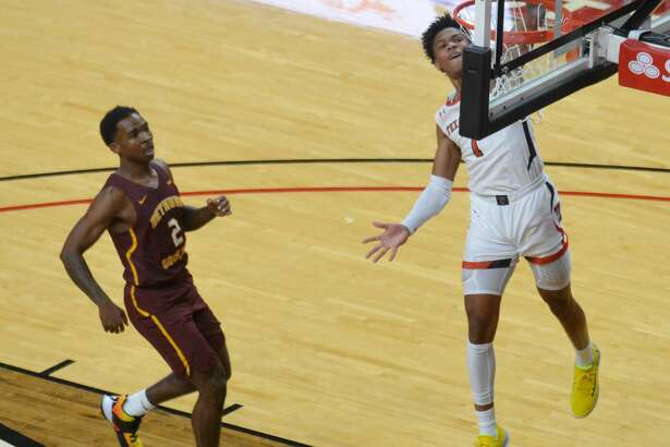 Texas Tech freshman Terrence Shannon, Jr. slams home a Fastbreak dunk in front of Bethune-Cookman's Houston Smith during their men's college basketball game on Saturday night in the United Supermarkets Arena.