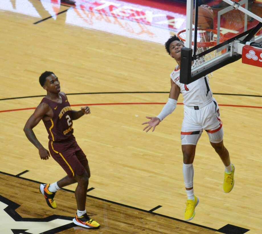 Texas Tech freshman Terrence Shannon, Jr. slams home a Fastbreak dunk in front of Bethune-Cookman's Houston Smith during their men's college basketball game on Saturday night in the United Supermarkets Arena. Photo: Nathan Giese/Planview Herald