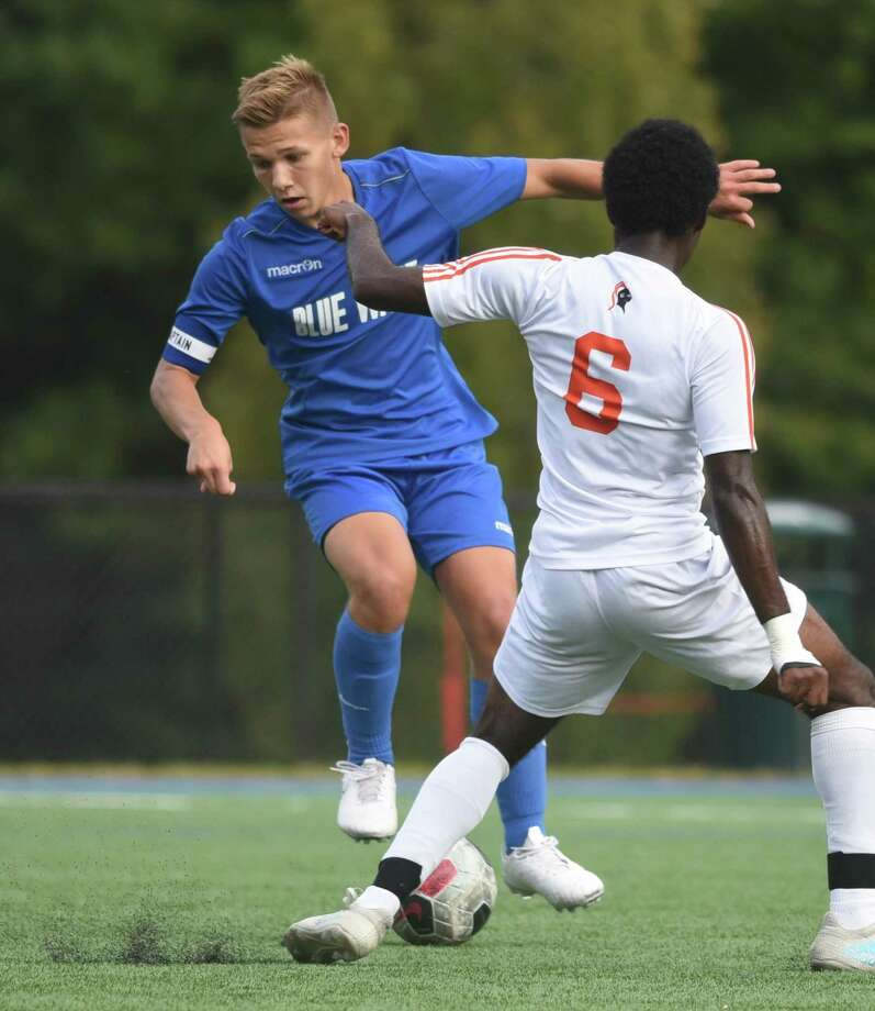 Darien's Charlie Sears (10) controls the ball away in front of Stamford's Ricarson Michael (6) during a boys soccer game in Darien on Monday, Oct. 7, 2019. Photo: Dave Stewart / Hearst Connecticut Media / Hearst Connecticut Media