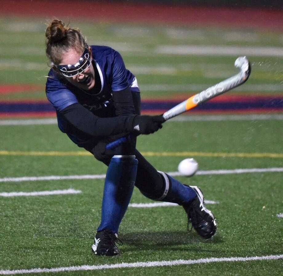Staples' Grace Cooper sends the ball upfield during the FCIAC field hockey final between Staples and Darien at Brien McMahon on Thursday, Nov. 7, 2019. The game ended in a 0-0 tie after two overtimes, and the teams were declared co-champions. Photo: David Stewart / Hearst Connecticut Media / Connecticut Post