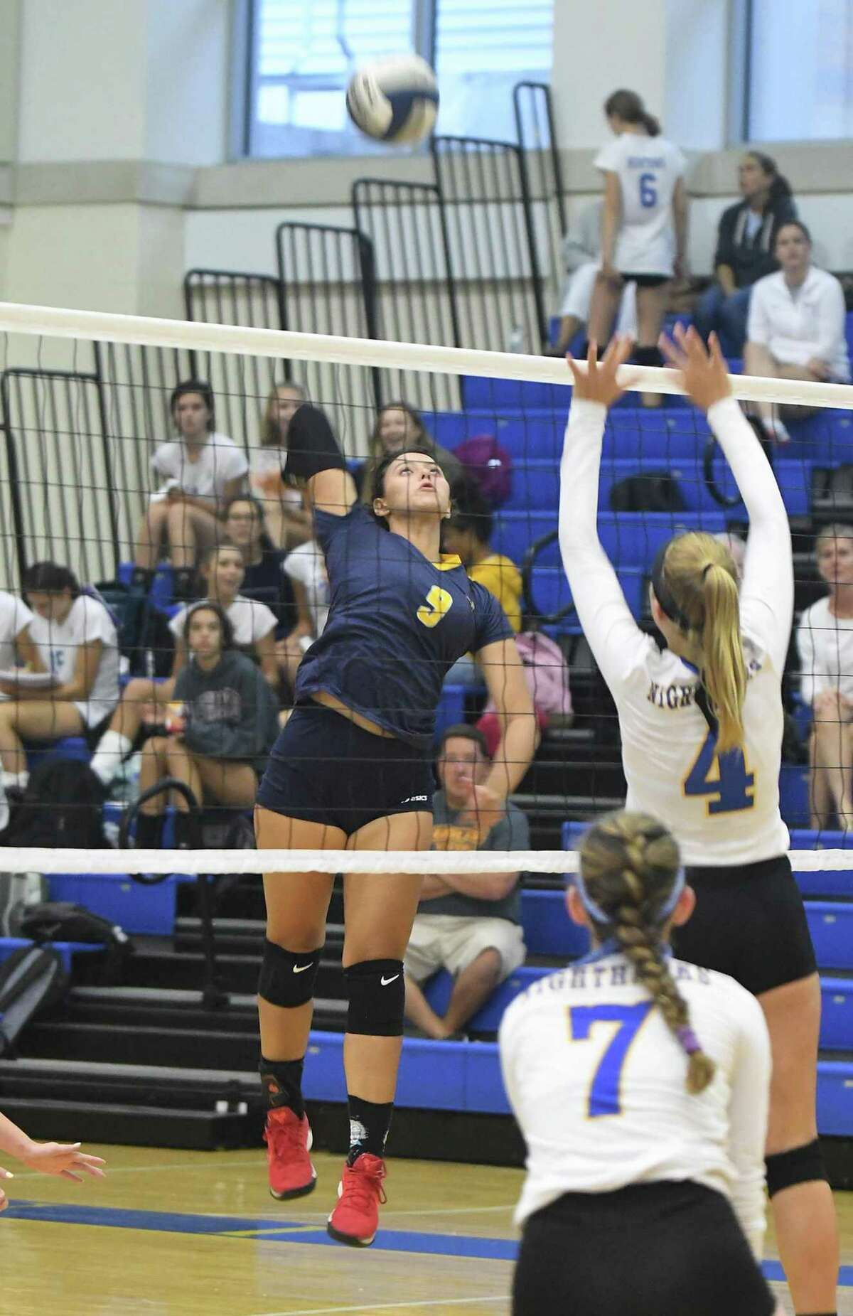 Woodstock Academy's Paula Hernandez (9) during the Woodstock Academy at Newtown High School girls volleyball game, Sept. 17, 2018.