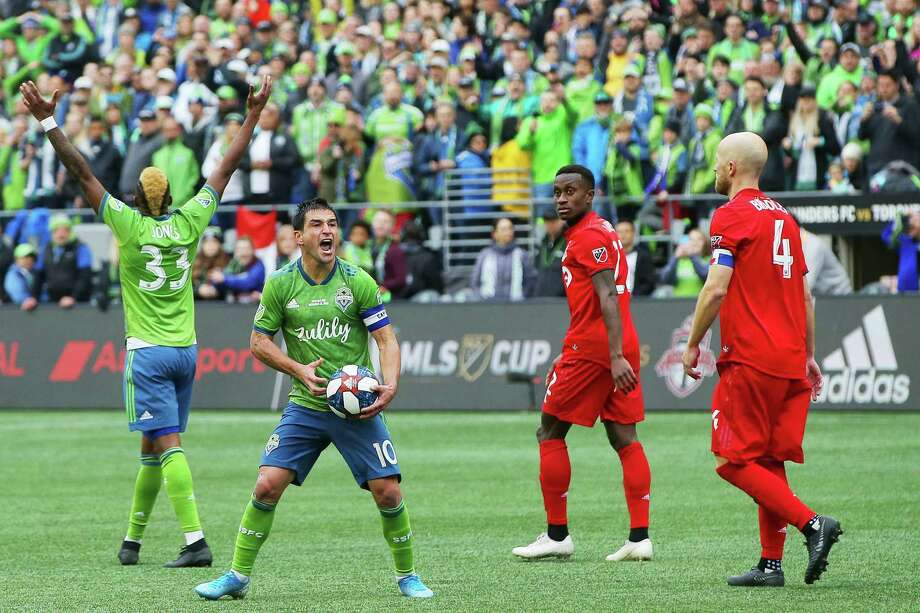 Seattle Sounders midfielder Nicolas Lodeiro (10) and defender Joevin Jones (33) celebrate as the final whistle blows, ending the MLS Cup final game against Toronto FC, Sunday, Nov. 10, 2019 at CenturyLink Field. The Sounders won 3-1. Photo: Genna Martin, Seattlepi.com / GENNA MARTIN
