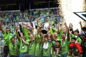 The Seattle Sounders celebrate with the Philip F. Anschutz trophy after winning the MLS Cup final 3-1 against Toronto FC, Sunday, Nov. 10, 2019.