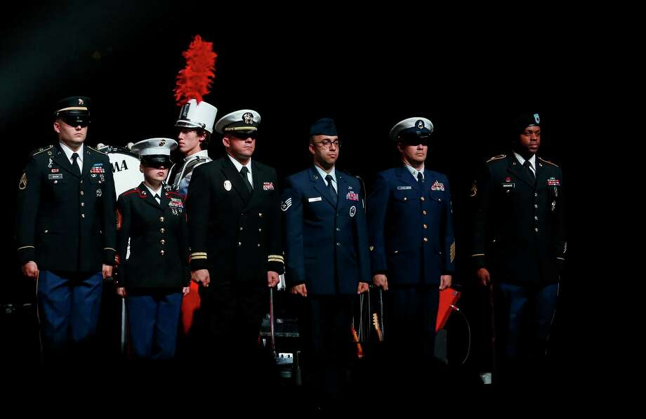 Members of the U.S. Armed Forces Color Guard on stage during the singing of the national anthem before the start of the third annual VetsAid Concert at the Toyota Center Sunday, Nov. 10, 2019, in Houston. Photo: Godofredo A. Vásquez, Staff Photographer / © 2019 Houston Chronicle