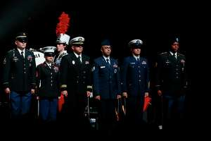 Members of the U.S. Armed Forces Color Guard on stage during the singing of the national anthem before the start of the third annual VetsAid Concert at the Toyota Center Sunday, Nov. 10, 2019, in Houston.