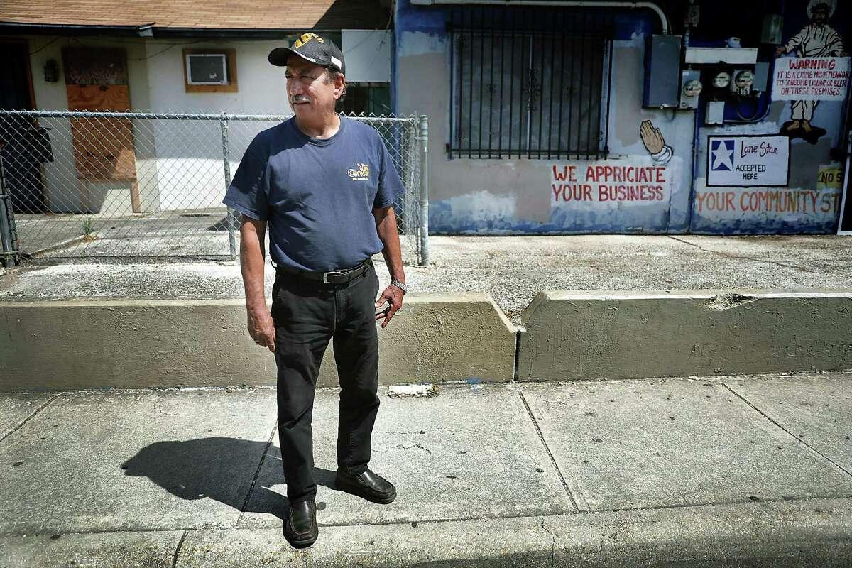 Army veteran Hector Caldera stands in the spot where he saw his high school buddy, Adam, get shot across the street from the Good Samaritan Center on Saltillo Street.
