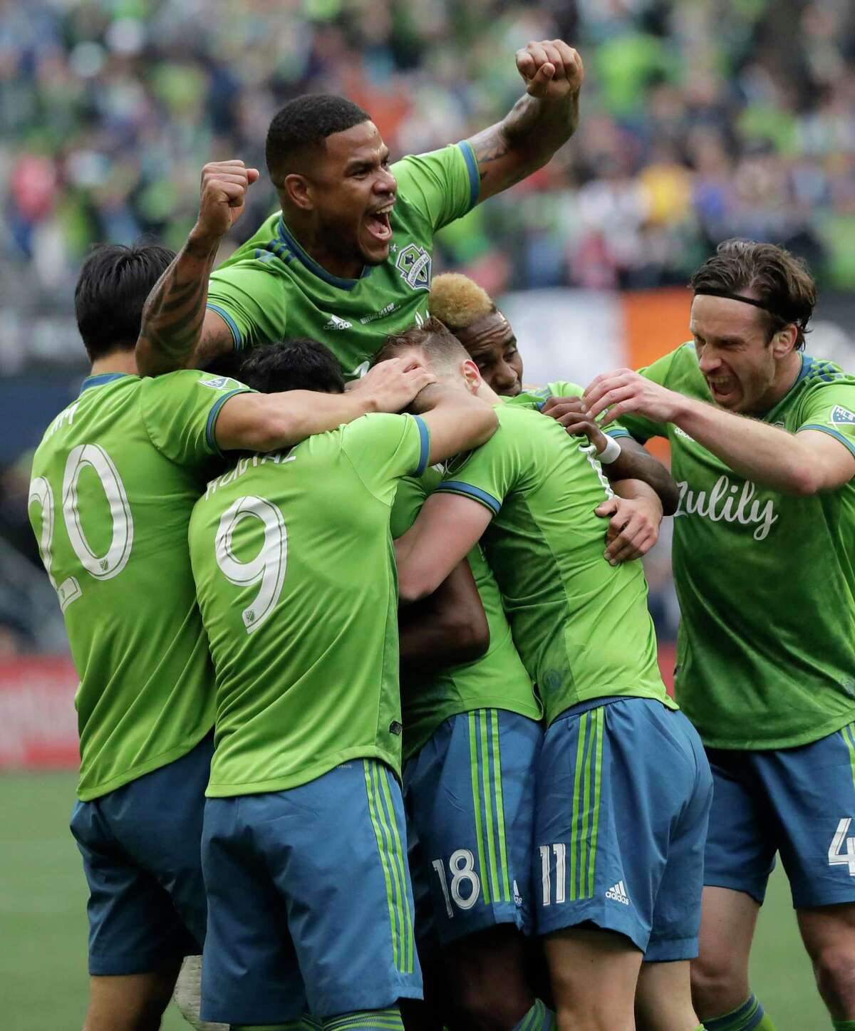 Seattle Sounders' Roman Torres, top, celebrates after teammate Kelvin Leerdam scored against the Toronto FC, Sunday, Nov. 10, 2019, during the second half of the MLS Cup championship soccer match in Seattle. (AP Photo/Ted S. Warren)