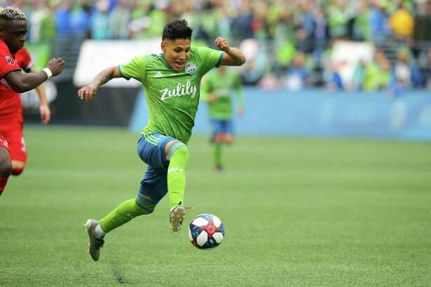 Seattle Sounders forward Raul Ruidiaz (9) shoots and scores a third goal for the Sounders during the second half of the MLS Cup final, Sunday, Nov. 10, 2019.