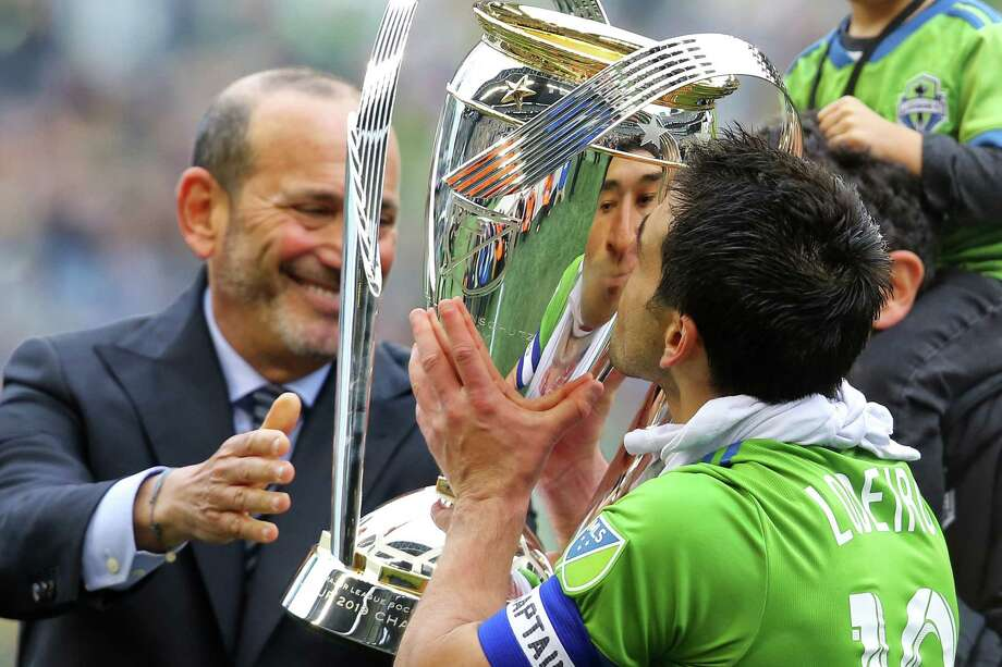 Seattle Sounders midfielder Nicolas Lodeiro (10) kisses the  Philip F. Anschutz trophy after winning the MLS Cup final 3-1 against Toronto FC, Sunday, Nov. 10, 2019. Photo: Genna Martin, Seattlepi.com / GENNA MARTIN