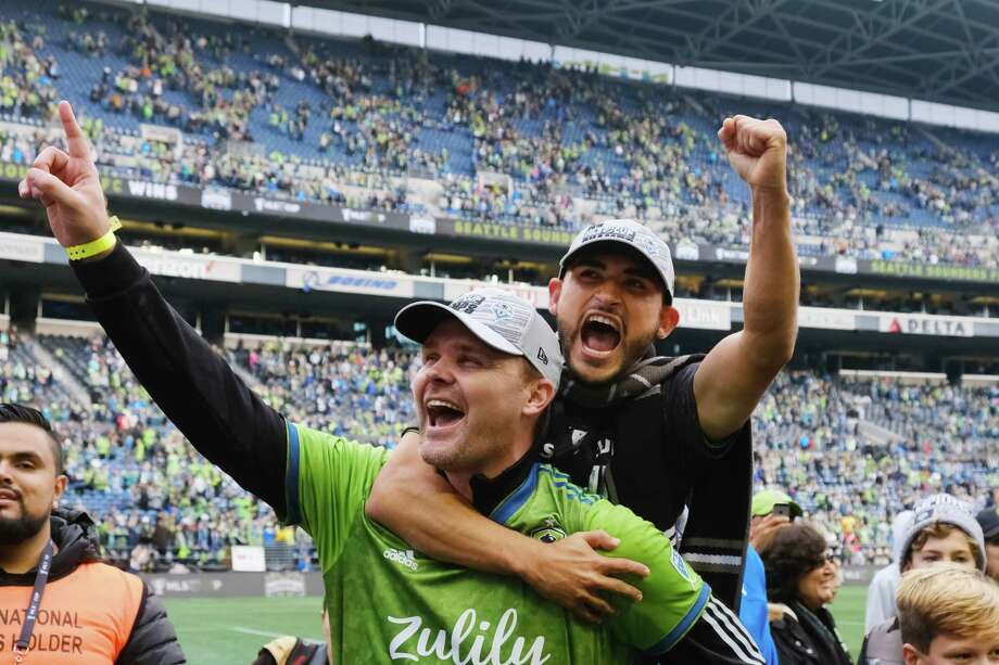 Seattle Sounders midfielder Cristian Roldan (7) jumps on the back of former Sounders player Chad Marshall after winning the MLS Cup final 3-1 against Toronto FC, Sunday, Nov. 10, 2019. Photo: Genna Martin, Seattlepi.com / GENNA MARTIN