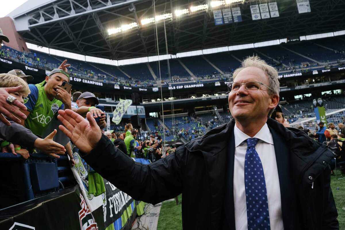 Sounders head coach Brian Schmetzer greets fans after Seattle won the MLS Cup final 3-1 against Toronto FC, Sunday, Nov. 10, 2019.