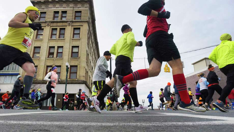 Runners make their way along State Street during the start of the Stockade-athon on Sunday, Nov. 10, 2019, in Schenectady, N.Y.  (Paul Buckowski/Times Union) Photo: Paul Buckowski / (Paul Buckowski/Times Union)