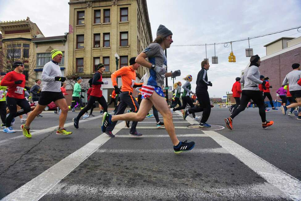 Runners make their way along State Street during the start of the Stockade-athon on Sunday, Nov. 10, 2019, in Schenectady, N.Y. (Paul Buckowski/Times Union)