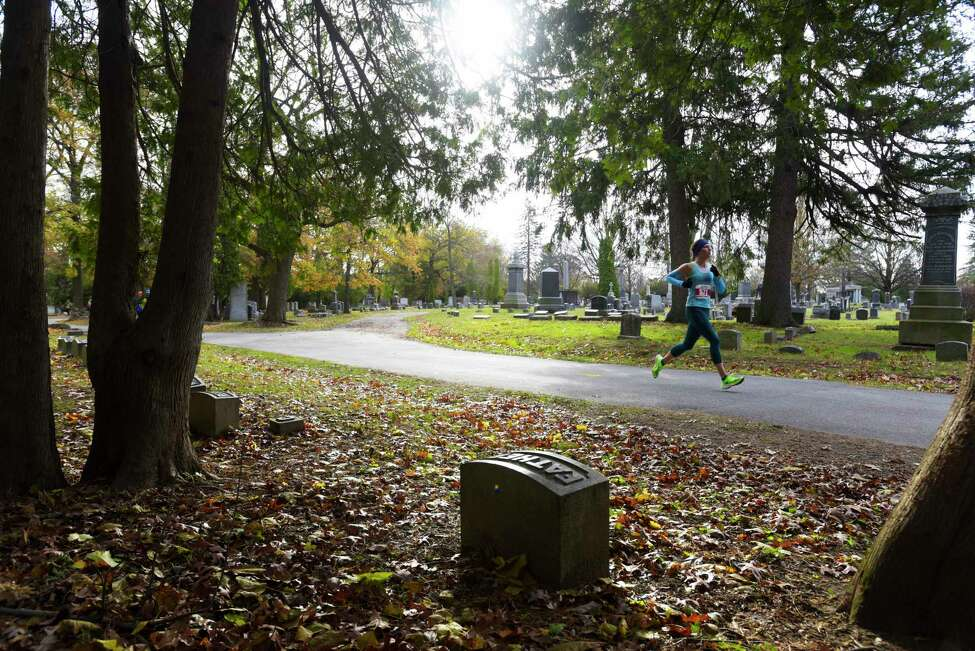 Runner Megan Harrington of Cambridge makes her way through Vale Cemetery during the Stockade-athon on Sunday, Nov. 10, 2019, in Schenectady, N.Y. (Paul Buckowski/Times Union)