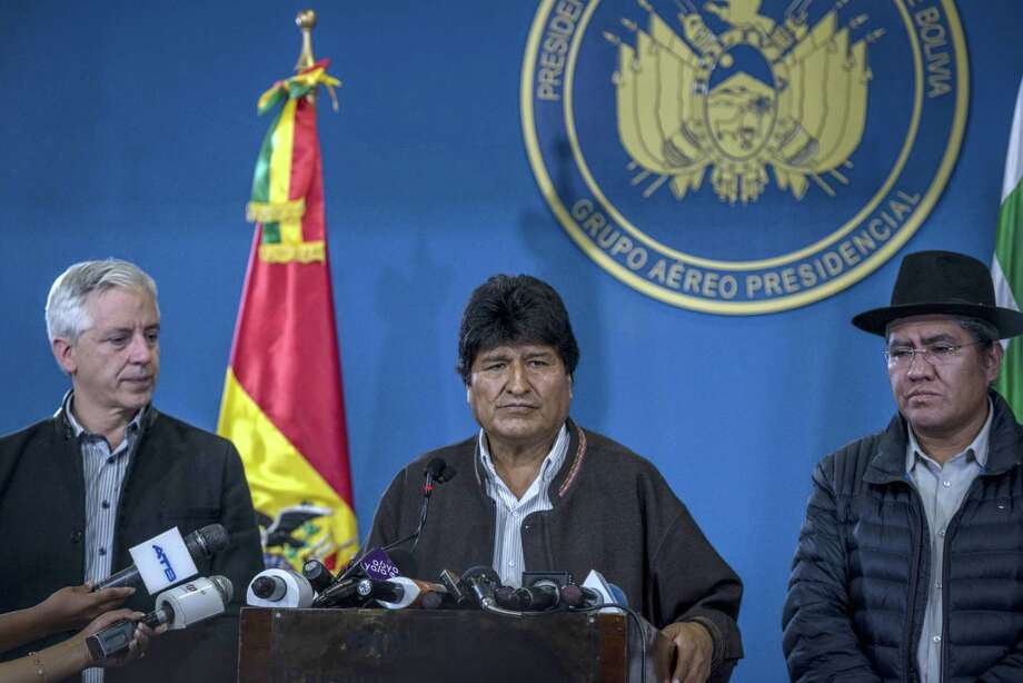 Bolivian President Evo Morales speaks next to Vice President Alvaro Garcia Linera, left, and Chancellor Diego Pary at El Alto, Bolivia, on Saturday, Nov. 9, 2019. Photo: Bloomberg Photo By Marcelo Perez Del Carpio. / 2019 Bloomberg Finance LP
