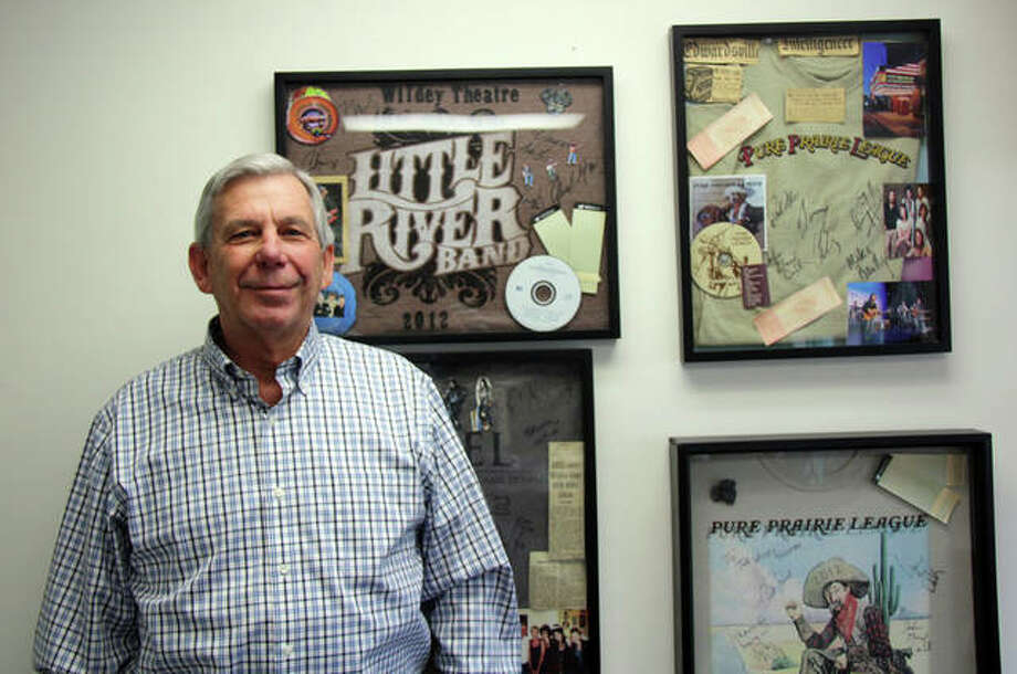 Bob Pfeiffer, the city's parks director since 1982, will step down Dec. 6, after nearly 45 years of service to the city of Edwardsville. Behind him are shadowboxes that one of his daughters made of bands that either visited the Wildey Theatre or are personal favorites. Photo: Charles Bolinger | The Intelligencer