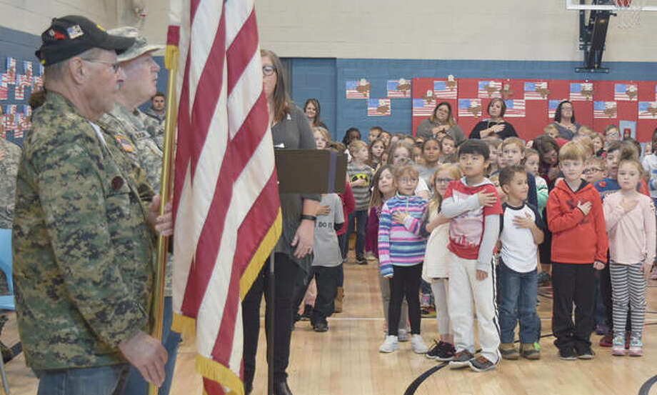 Members of the AmVets color guard present the flag Friday during the South Jacksonville Elementary School Veterans Day ceremony. Photo: Samantha McDaniel-Ogletree | Journal-Courier