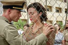 "This image released by Lionsgate shows Ed Skrein, left, and Mandy Moore in a scene from ""Midway."" (Reiner Bajo/Lionsgate via AP)"