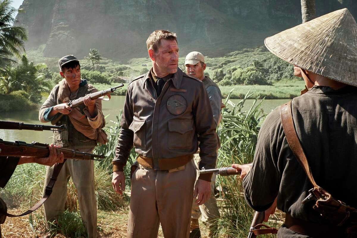This image released by Lionsgate shows Aaron Eckhart in a scene from