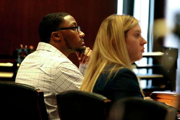 In this Wednesday, Oct. 23, 2019 photo, defendant Khalil Wheeler-Weaver listens to opening arguments during his triple murder trial in Newark, N.J. Wheeler-Weaver is charged with strangling and asphyxiating three women in the fall of 2016. He's also accused in the attempted murder of a fourth woman. (George McNish/NJ Advance Media via AP, Pool)