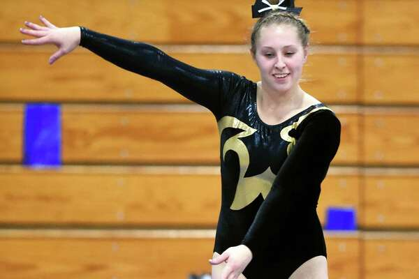 (Arnold Gold-New Haven Register) Jonathan Law captain Melanie Coleman performs on the beam during the SCC 2017 Gymnastics Championship at Jonathan Law High School in Milford on 2/10/2017.
