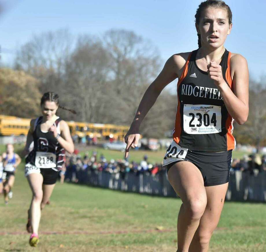 Ridgefield's Tess Pisanelli (right) earned All-New England honors for a second straight year. Photo: Ryan Lacey / Hearst Connecticut Media
