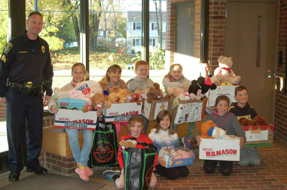 The Daniels Farm Student Council collected teddy bears fecently for the Trumbull Police Department's Teddy Bears for Trumbull drive. The teddy bears will be given to children in times of crisis or need. The Daniels Farm students donated the new, medium sized teddy bears during their first Play Day of the year. The Student Council members delivered almost 50 bears to the Police Department for this program. Photo: Contributed Photos
