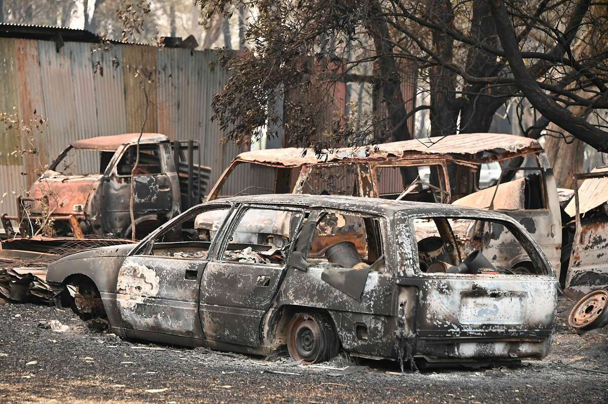 """The burnt-out remains of cars and property belonging to Art Murphy and his wife Shirley are seen following bushfires in Old Bar, 350km north of Sydney on November 11, 2019. - A state of emergency on November 11 was declared and residents in the Sydney area were warned of """"catastrophic"""" fire danger as Australia girded for a fresh wave of deadly bushfires that have ravaged the drought-stricken east of the country. (Photo by PETER PARKS / AFP) (Photo by PETER PARKS/AFP via Getty Images)"""