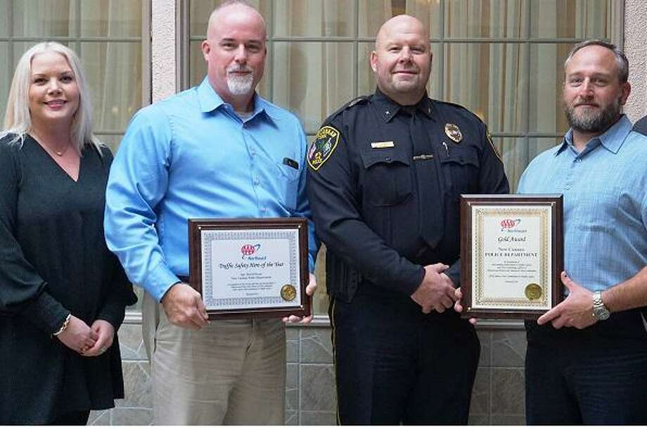 At AAA's 10th annual Community Traffic Safety Awards lunch at Testo's in Bridgeport, AAA District Branch Director Laura Lipnickas presented Deputy Chief John DiFederico, Sgt. David Payne and Officer Dan Gulino with awards. Photo: Contributed Photo