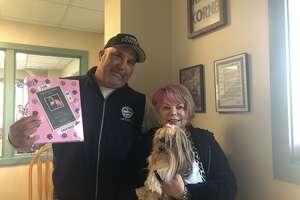 Shelton Animal Shelter Supervisor Leon Sylvester with Kathy Yolish and her dog, Kinzy.