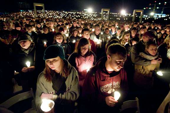 Thousands gather during a candlelight memorial service Wednesday, Nov. 18, 2009 in College Station, TX in observance of the tenth anniversary of the 1999 Bonfire collapse. The 1999 collapse killed 12 Aggies. The service was held at the exact time the Bonfire stack collapsed in 1999 on the former site of the Bonfire, where a memorial now stands. (AP Photo/College Station Eagle - Stuart Villanueva)