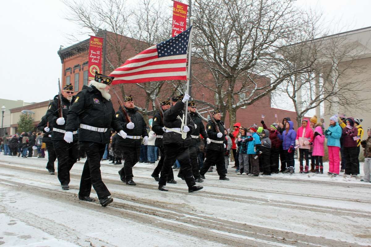 A little snowstorm didn't stop area residents from lining the streets in Big Rapids to honor area veterans on Monday - Veterans Day.