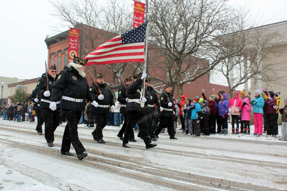 A little snowstorm didn't stop area residents from lining the streets in Big Rapids to honor area veterans on Monday — Veterans Day. Photo: Bradley Massman/Pioneer Photo