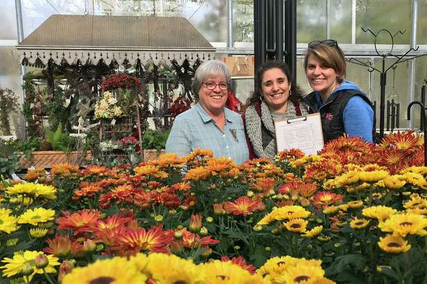 Susan Bergen of New Canaan Land Trust, Jennifer Cipriano of Copia Nursery and Robin Bates-Mason of Planet New Canaan hold the list of customers who took part in the Native Plant sale to benefit New Canaan Land Trust.