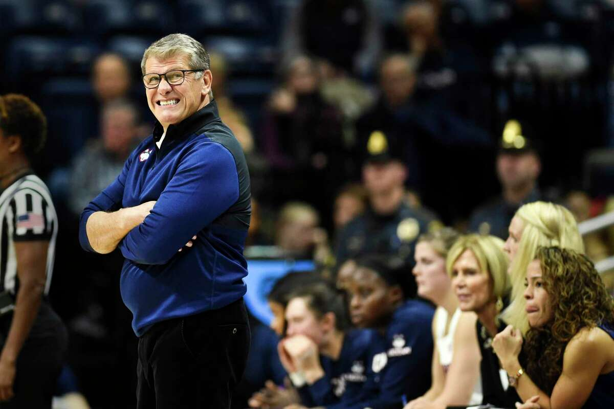 UConn coach Geno Auriemma, left, reacts during the first half of against California Sunday in Storrs.
