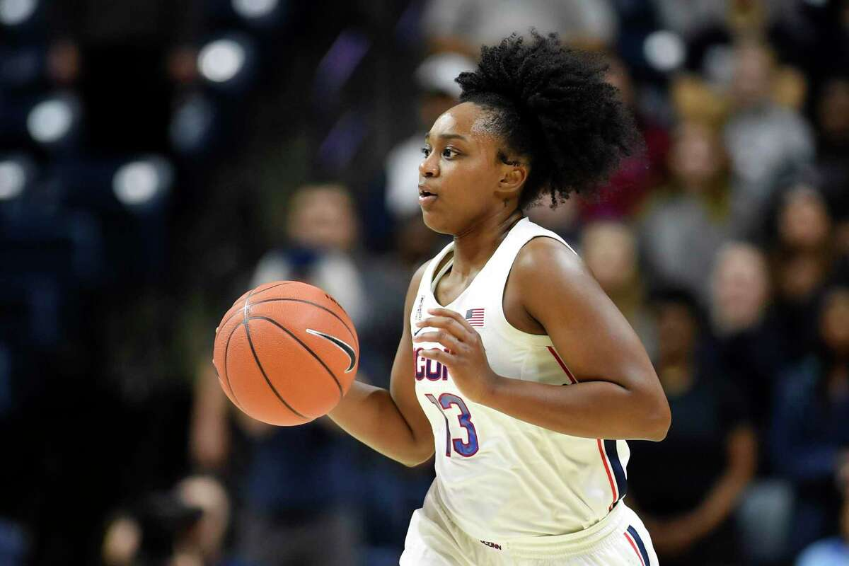 Christyn Williams (13) drives downcourt during the first half of an NCAA college basketball game against California Sunday, Nov. 10, 2019, in Storrs, Conn. (AP Photo/Stephen Dunn)