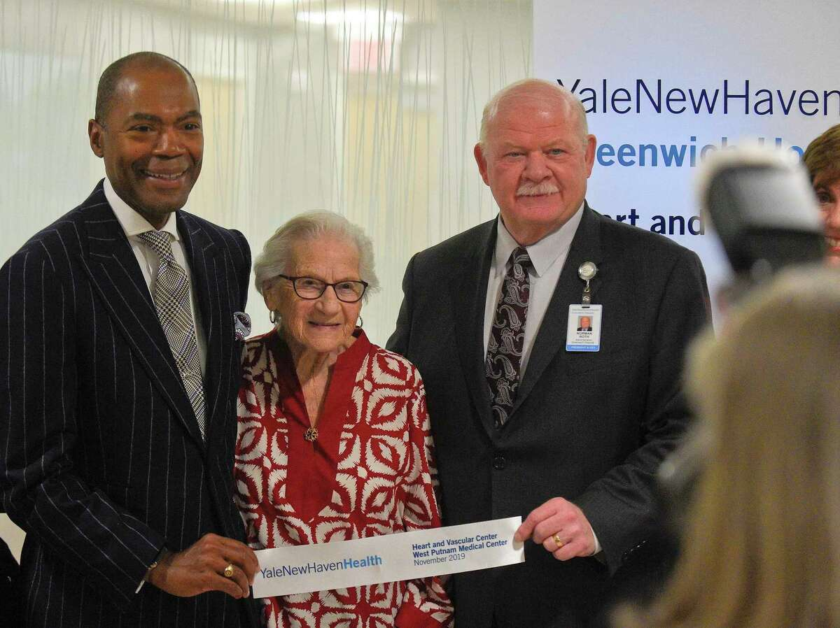 From left, Dr. Keith Churchwell, Executive Director of the Yale New Haven Health Greenwich Hospital Heart and Vascular Center, Doris Rabinowitz, 95, YNHHGH Heart and Vascular Center's first patient and Norman Roth, President and CEO of Greenwich Hospital are photograph during Yale New Haven Health's opening of the West Putnam Medical Center, an outpatient facility that offers services provided by Greenwich Hospital, Northeast Medical Group and Yale New Haven Health Heart and Vascular Center on Nov. 7, 2019 in Greenwich, Connecticut.