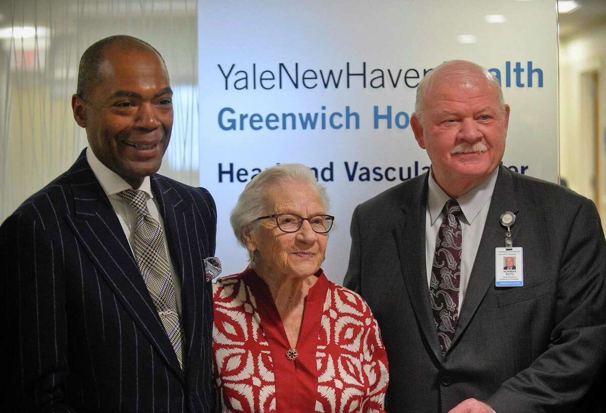 From left, Dr. Keith Churchwell, Executive Director of the Yale New Haven Health Greenwich Hospital Heart and Vascular Center, Doris Rabinowitz, 95, YNHHGH Heart and Vascular Center's first patient and Norman Roth, President and CEO of Greenwich Hospital are photograph during Yale New Haven Health's opening of the West Putnam Medical Center.