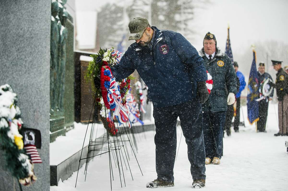State Sen. Jim Stamas places a wreath in front of the Midland Veterans Memorial during a Veterans Day ceremony Monday, Nov. 11, 2019. (Katy Kildee/kkildee@mdn.net)